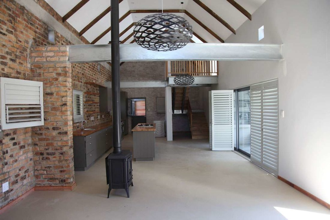 Open plan lounge / dining / kitchen with cathedral ceiling